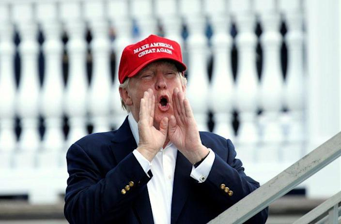 Trump shouts as he arrives at the U.S. Women's Open at Trump National Golf Club in Bedminster, N.J., on Saturday. (Kevin Lamarque/Reuters)