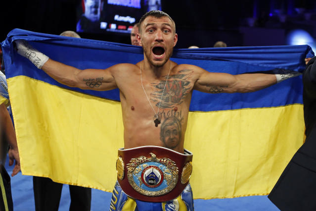 FILE - In this Dec. 9, 2017, file photo, Vasiliy Lomachenko, of Ukraine, celebrates after defeating Guillermo Rigondeaux in a WBO junior lightweight title boxing match in New York. Lomachenko is back and ready to show what he can do with two healthy shoulders. Injured while winning one lightweight belt, Lomachenko while try to add a second in his return from surgery when he faces Jose Pedraza on Saturday night in the Theater at Madison Square Garden. (AP Photo/Adam Hunger, File)