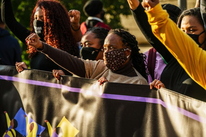 Demonstrators gather around Rep. Attica Scott (D-KY) and other members of the Black Women's Collective during a march to the Breonna Taylor memorial at Jefferson Square Park on October 3, 2020, in Louisville, Ky.
