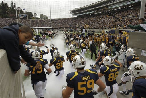 California football players run on to the field for their NCAA college football game against Nevada at Memorial Stadium, Saturday, Sept. 1, 2012, in Berkeley, Calif. (AP Photo/Ben Margot)
