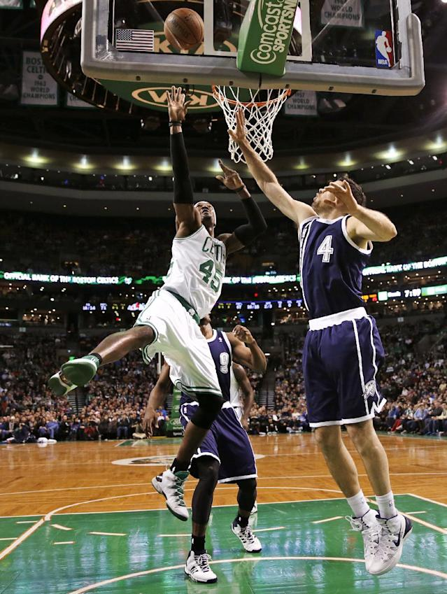 Boston Celtics forward Gerald Wallace (45) shoots against Oklahoma City Thunder forward Nick Collison (4) during the first half of an NBA basketball game in Boston, Friday, Jan. 24, 2014. (AP Photo/Charles Krupa)
