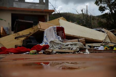 Debris is seen outside a home damaged by Hurricane Maria is seen in the Trujillo Alto municipality outside San Juan, Puerto Rico, October 9, 2017. REUTERS/Shannon Stapleton