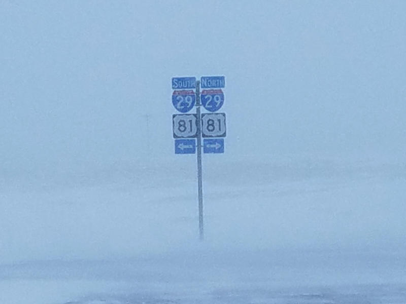 A blizzard packing winds of 50 mph or more reduced visibility to near zero at the intersections of Interstate 94 and Interstate 29 in Fargo, N.D., on Saturday, Jan. 18, 2020. Interstate 94 was shut down from Fargo to Bismarck, N.D., and Interstate 29 was closed from Grand Forks, N.D., to Sioux Falls, S.D. No travel was advised on secondary roads in states within the blizzard warning, which included parts of North Dakota, South Dakota, Minnesota and Iowa. (Jim Monk/KFGO Radio, Fargo via AP)