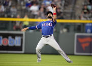 Texas Rangers shortstop Isiah Kiner-Falefa pulls in a shallow fly ball off the bat of Colorado Rockies' Charlie Blackmon to end the fifth inning of a baseball game Wednesday, June 2, 2021, in Denver. (AP Photo/David Zalubowski)
