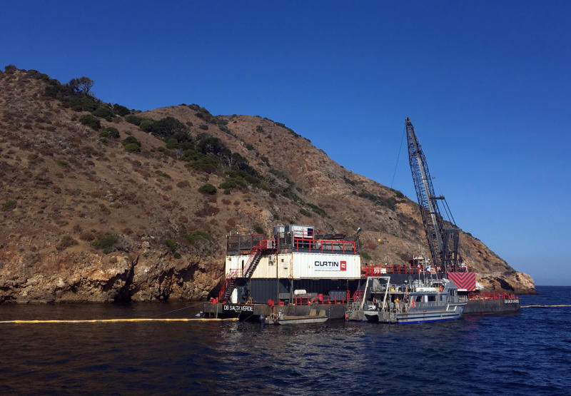 This photo provided by the U.S. Coast Guard shows the derrick barge Salta Verde engaged in salvage operations over the wreck of the dive boat Conception at Santa Cruz Island off the coast of Southern California Friday, Sept. 6, 2019. The Conception burned and sank Sept. 2, taking the lives of 34 people. (U.S. Coast Guard via AP)