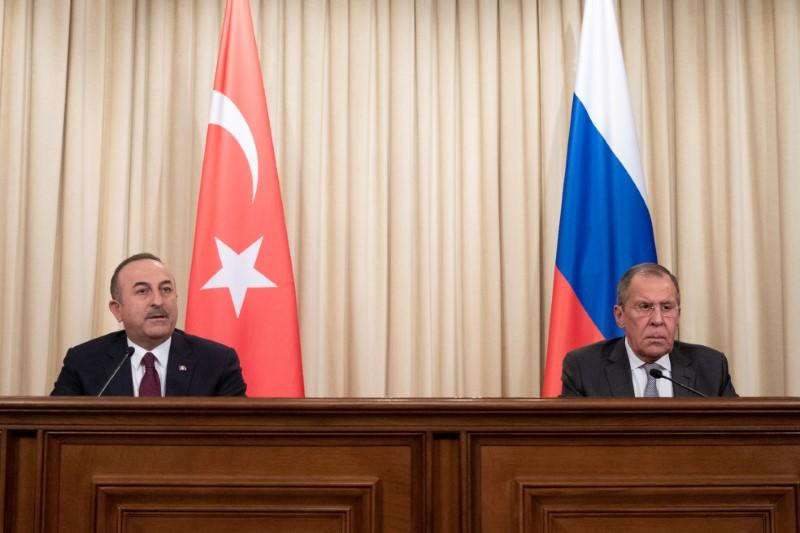 Turkish Foreign Minister Mevlut Cavusoglu and Russian Foreign Minister Sergei Lavrov attend a joint news conference following their talks in Moscow