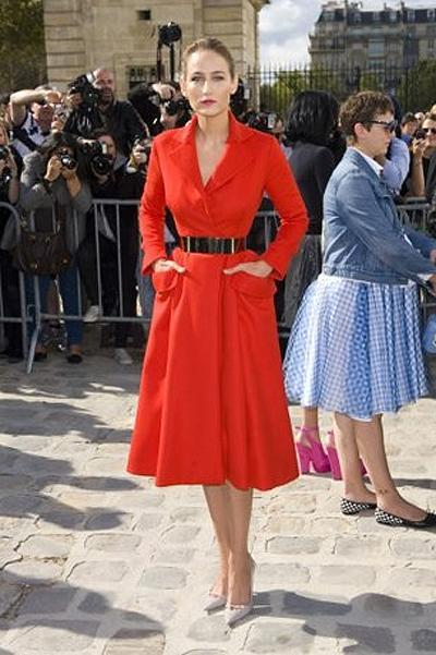 <p><b>Leelee Sobieski</b></p> <p>It's fitting that actress Leelee Sobieski, who only earlier this year wore a luminous white poplin dress from Raf Simon's penultimate collection for Jil Sander, would don a vibrant poppy red coatdress from his debut Christian Dior Couture collection-it made for an exquisite and resounding 'welcome back'-and to attend his first spring/summer 2012 ready-to-wear show for the house, no less.</p>
