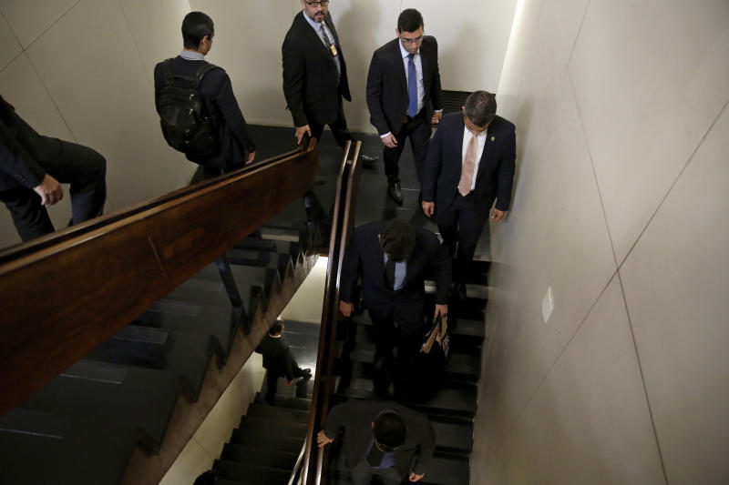 Federal Police leave after searching the office of Senator Fernando Bezerra Coelho, the government leader in the Federal Senate, in Brasilia, Brazil, Thursday, Sept. 19, 2019. Bezerra Coelho is one of the targets of a federal police operation into a possible kick-back scheme allegedly carried out when he was in the Cabinet of former President Dilma Rousseff, according to authorities. (AP Photo/Eraldo Peres)