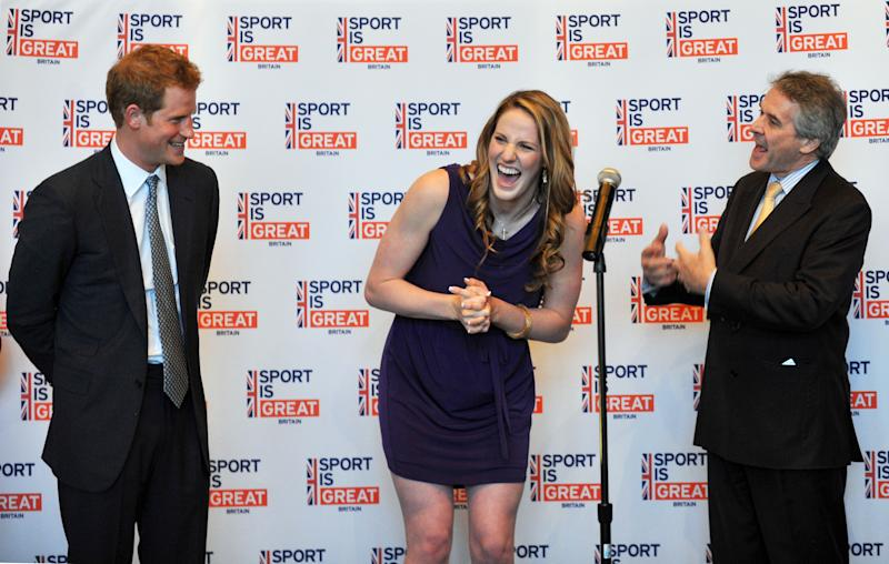 Britain's Prince Harry, left, and British Ambassador Peter Westmacott, right, celebrate the 18th birthday of Gold medal swimmer Missy Franklin, center, during a reception at the Sanctuary Golf Course clubhouse in Sedalia, Colo., Friday, May 10, 2013. The visit is part of a weeklong visit to the United States that started in Washington and will also include trips to parts of New Jersey damaged by Superstorm Sandy. (AP Photo/The Denver Post, Hyoung Chang, Pool)