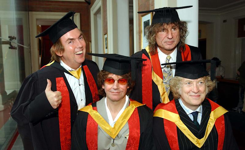 Former members of the band 'Slade' (from left) - Noddy Holder, Dave Hill, Jim Lea and Don Powell, collect their honorary followships from their home town University of Wolverhampton. * The band who recorded 17 consecutive top 20 hits between 1971 and 1976 were being honored in recognition of their contribution to the music industry.