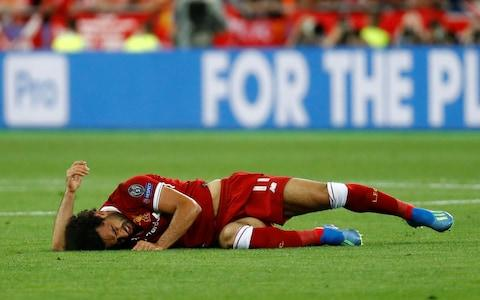 Mo Salah has to depart with an injured shoulder - Credit:  REUTERS/Kai Pfaffenbach