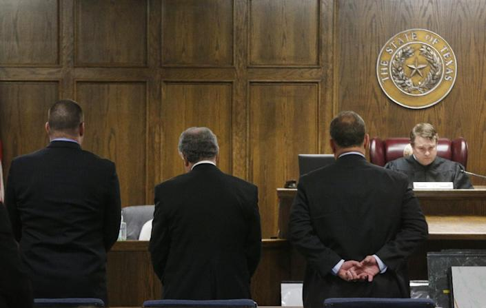 Judge Jason Cashon reads the sentence to ex-Marine Eddie Ray Routh Tuesday evening. (Michael Ainsworth/AP)