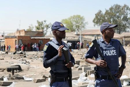 Police patrol the streets after overnight unrest and looting in Alexandra township, Johannesburg