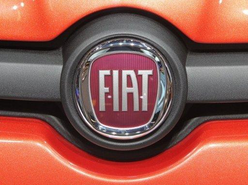 Fiat boss eyes Chrysler merger in 2014