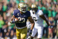 Notre Dame running back Kyren Williams (23) runs in for a touchdown in front of Purdue linebacker Jalen Graham (6) during the first half of an NCAA college football game in South Bend, Ind., Saturday, Sept. 18, 2021. (AP Photo/Michael Conroy)