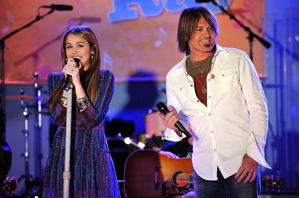 """Teen queen Miley Cyrus says she was bitten by the performance bug watching her """"Achy Breaky Heart"""" singer-turned-actor father Billy Ray Cyrus on the set of his show """"Doc."""" Now a little show called """"Hannah Montana"""" and four albums later, she's ranked number 13 on <i>Forbes'</i> list of the world's most powerful celebs. Bryan Bedder/<a href=""""http://www.gettyimages.com/"""" target=""""new"""">GettyImages.com</a> - April 8, 2009"""