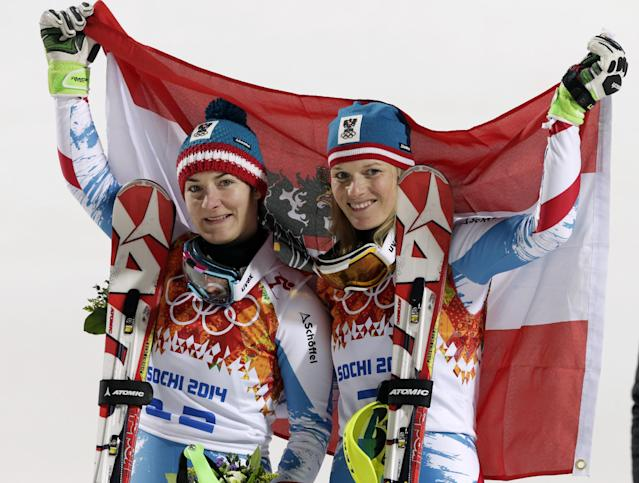 Women's slalom winners from Austria Kathrin Zettel (bronze) and Marlies Schild (silver) pose for photographers at the Sochi 2014 Winter Olympics, Friday, Feb. 21, 2014, in Krasnaya Polyana, Russia. (AP Photo/Gero Breloer)