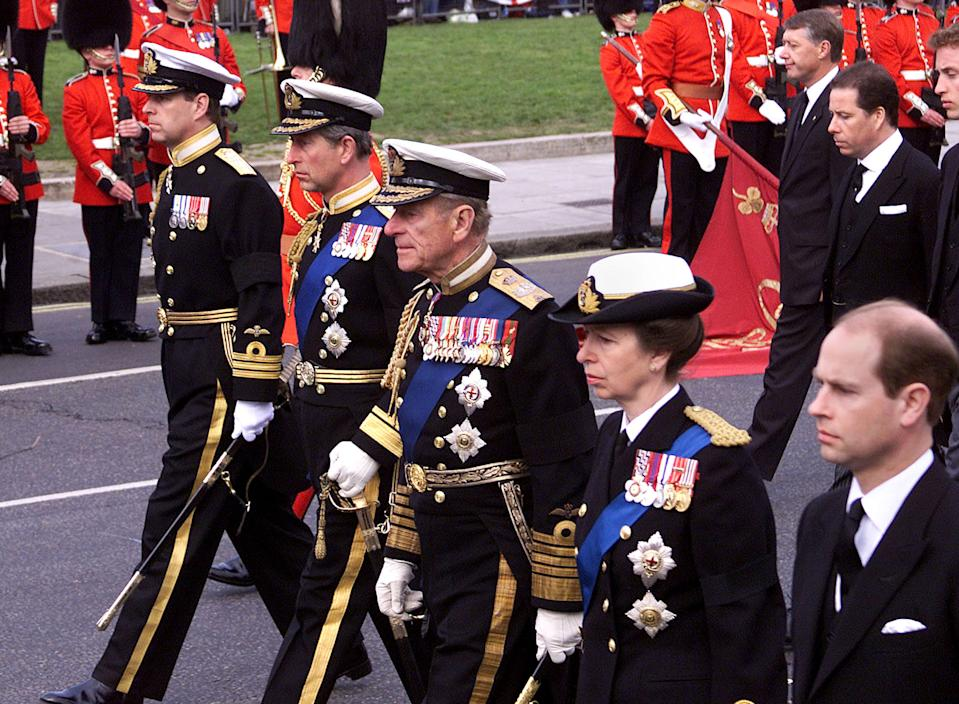 403595 01: (L to R) Britain's Prince Andrew, Prince Charles, The Duke of Edinburgh, Princess Anne and Prince Edward follow the body of the Queen Mother to Westminster Abbey during her funeral April 9, 2002 in London. The coffin will be taken from Westminster Abbey in a hearse to Windsor where she will be interred with her husband King George VI. (Photo by Hugo Philpott/Getty Images)