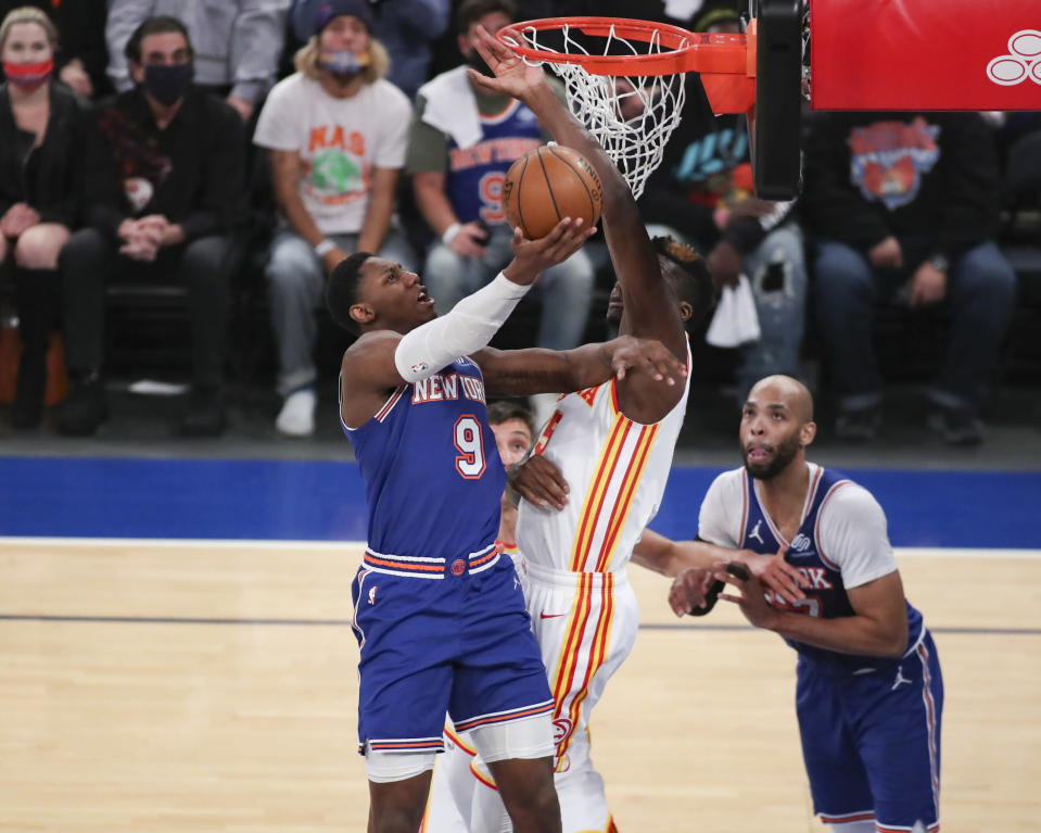 New York Knicks guard RJ Barrett (9) shoots against Atlanta Hawks center Clint Capela (15) during the first quarter of Game 5 of an NBA basketball first-round playoff series Wednesday, June 2, 2021, in New York. (Wendell Cruz/Pool Photo via AP)