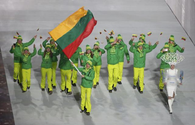 Lithuania's flag-bearer Deividas Stagniunas leads his country's contingent during the opening ceremony of the 2014 Sochi Winter Olympics, February 7, 2014. REUTERS/Lucy Nicholson (RUSSIA - Tags: OLYMPICS SPORT)