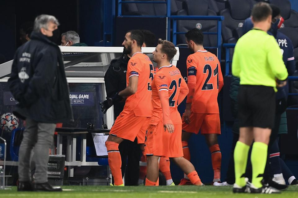 <p>Taking a stand | Basaksehir players walk off in Paris last December</p> (AFP via Getty Images)