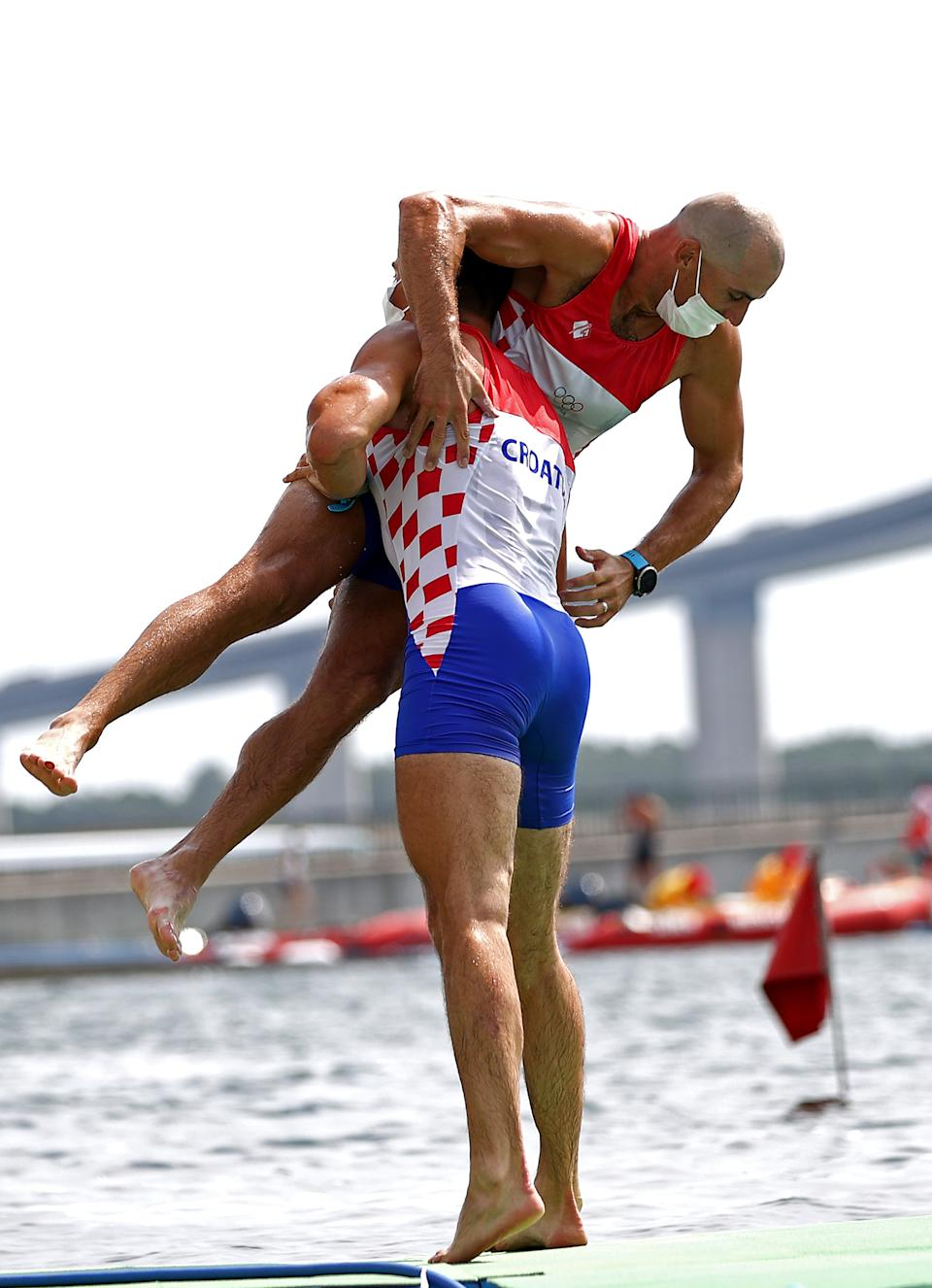 <p>Martin Sinkovic and Valent Sinkovic of Team Croatia celebrate winning the gold medal during the Men's Pair Final A on day six of the Tokyo 2020 Olympic Games at Sea Forest Waterway on July 29, 2021 in Tokyo, Japan. (Photo by Maja Hitij/Getty Images)</p>