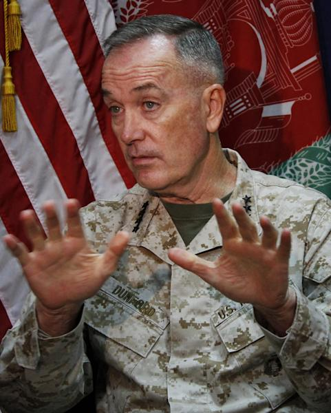Marine Gen. Joseph Dunford, who commands the U.S.-led International Security Assistance Force (ISAF), speaks during an interview with The Associated Press at the ISAF headquarters in Kabul, Afghanistan, Saturday, Aug. 10, 2013. The top U.S. and coalition commander in Afghanistan said the signing of a bilateral security agreement between America and Afghanistan will send a clear signal both to the Afghan people and the Taliban that the international community is committed to the future stability of the country even as foreign forces withdraw. (AP Photo/Ahmad Jamshid)