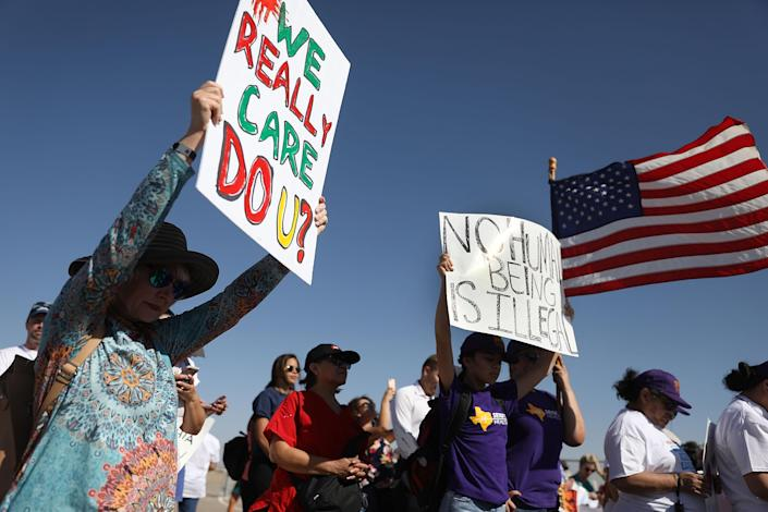 <p>People protest near the tent encampment recently built at the Tornillo-Guadalupe Port of Entry on June 24, 2018 in Tornillo, Texas. The group is protesting the separation of children from their parents after they were caught entering the U.S. under the administration's zero tolerance policy. (Photo: Joe Raedle/Getty Images) </p>