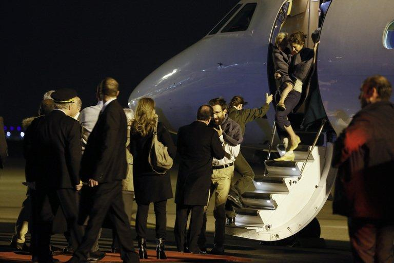 French President Francois Hollande (C) welcomes members of the Moulin-Fournier family at Orly airport,  April 20, 2013