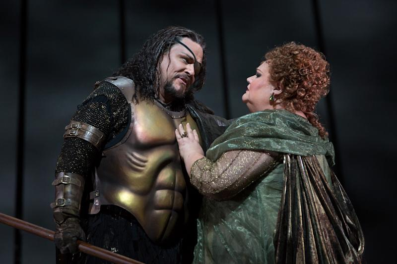 """In this April 3, 2013 photo provided by the Metropolitan Opera, Mark Delavan performs in the role of Wotan with Stephanie Blythe as Fricka in Wagner's """"Das Rheingold,"""" during the final dress rehearsal at the Metropolitan Opera in New York. (AP Photo/Metropolitan Opera, Marty Sohl)"""
