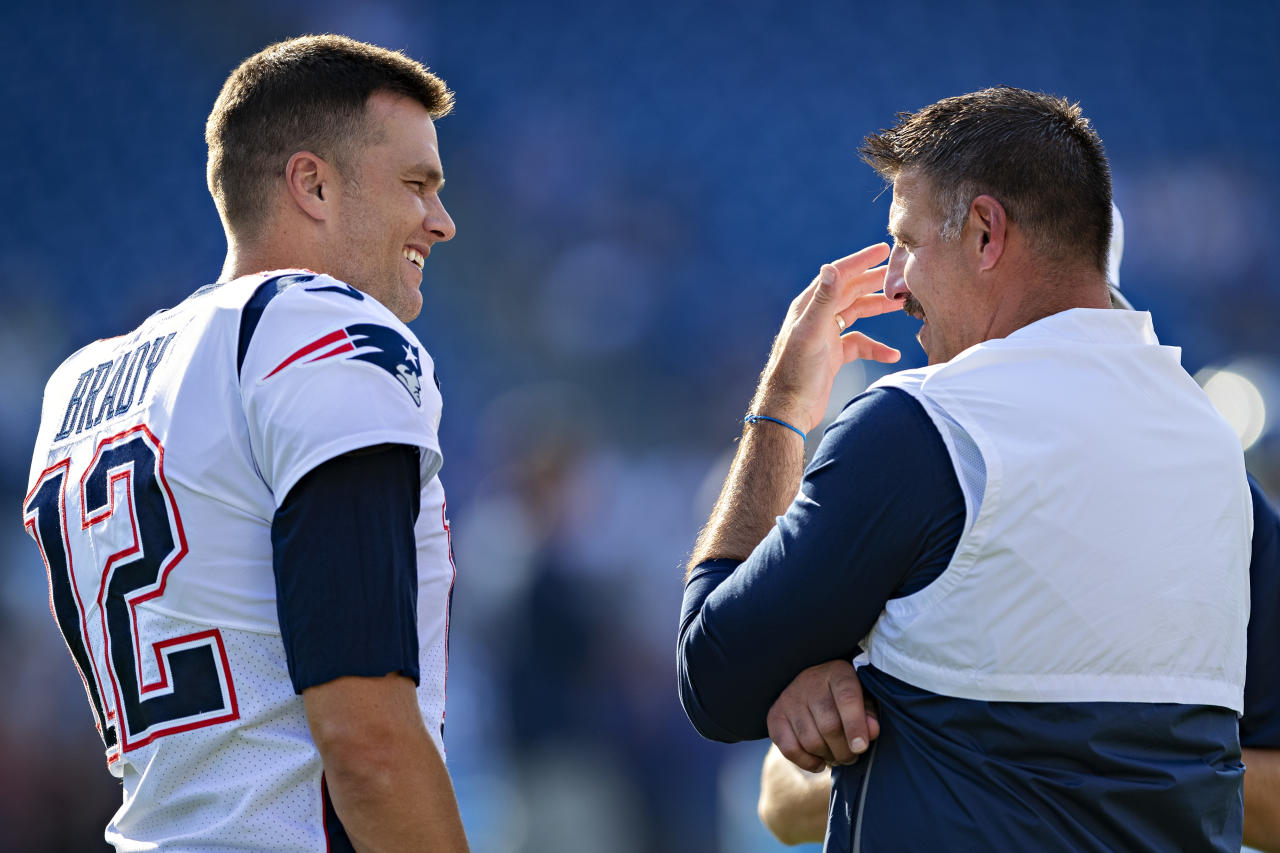 NASHVILLE, TN - AUGUST 17:  Tom Brady #12 of the New England Patriots talks with Head Coach Mike Vrabel of the Tennessee Titans before the game during week two of the preseason at Nissan Stadium on August 17, 2019 in Nashville, Tennessee.  The Patriots defeated the Titans 22-17.  (Photo by Wesley Hitt/Getty Images)