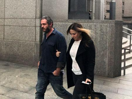 Joseph Meli and his wife, Jessica Meli, exit U.S. Federal Court in Manhattan , New York