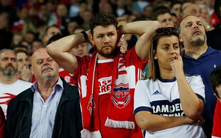 Soccer Football - Championship Play Off Semi Final Second Leg - Aston Villa v Middlesbrough - Villa Park, Birmingham, Britain - May 15, 2018 Middlesbrough fan looks dejected after the match Action Images via Reuters/Ed Sykes