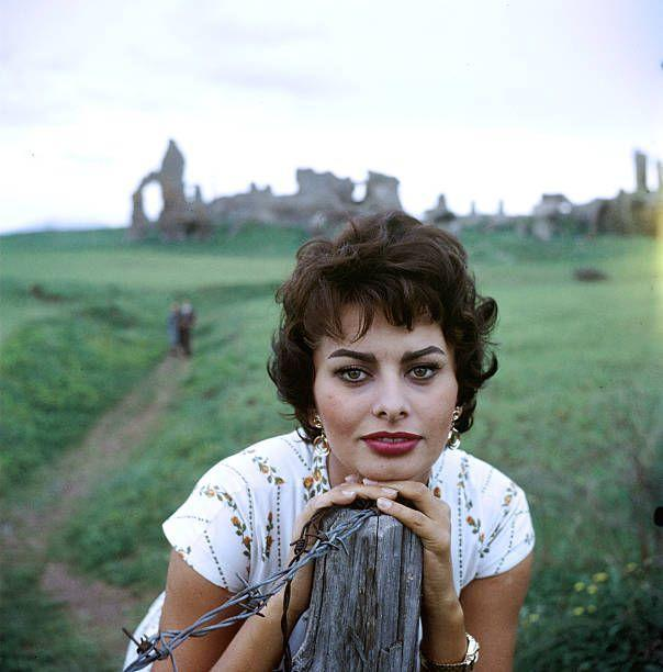 "<p>Growing up in extreme poverty, the <a href=""https://www.biography.com/actor/sophia-loren"" rel=""nofollow noopener"" target=""_blank"" data-ylk=""slk:Italian beauty's film career"" class=""link rapid-noclick-resp"">Italian beauty's film career</a> took off in the 1950s. She was highly regarded as one of the most stunning women in the world. Her film career blossomed, and she starred alongside Cary Grant and Frank Sinatra in <a href=""https://www.amazon.com/Pride-Passion-Cary-Grant/dp/B000062XF1/?tag=syn-yahoo-20&ascsubtag=%5Bartid%7C10055.g.34743066%5Bsrc%7Cyahoo-us"" rel=""nofollow noopener"" target=""_blank"" data-ylk=""slk:The Pride and the Passion"" class=""link rapid-noclick-resp""><em>The Pride and the Passion</em></a> (1957). She won a Best Actress Academy Award in 1961 for her role in <a href=""https://www.amazon.com/Two-Women-Sophia-Loren/dp/B01B4BJWIY/?tag=syn-yahoo-20&ascsubtag=%5Bartid%7C10055.g.34743066%5Bsrc%7Cyahoo-us"" rel=""nofollow noopener"" target=""_blank"" data-ylk=""slk:Two Women"" class=""link rapid-noclick-resp""><em>Two Women</em></a> (1961).</p>"