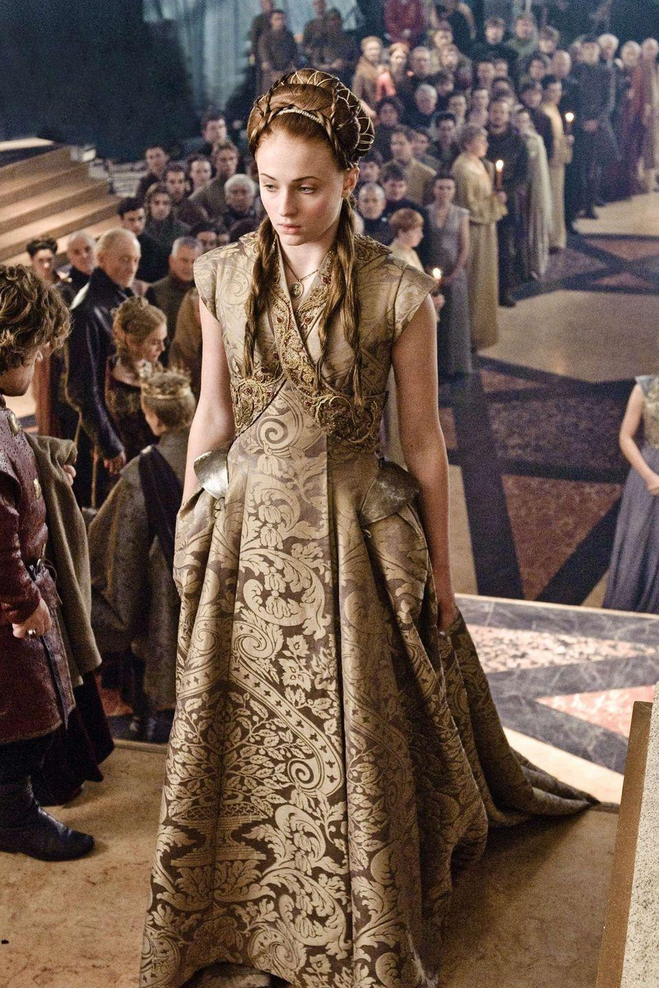 <p>At Sansa's wedding to Tyrion, she wears one of her most beautiful and most symbolic dresses of the series. It's gold (which makes it impossible <em>not</em> to think of the always-debt-paying Lannisters) and trimmed with lions, the Lannister sigil. The family is clearly sending Sansa a message: you belong to us now. </p>