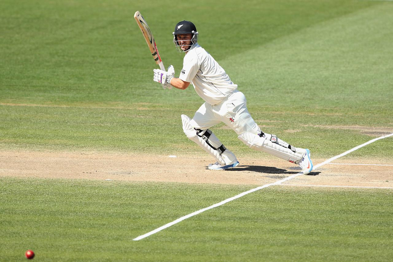 HAMILTON, NEW ZEALAND - DECEMBER 22: Hamish Rutherford of New Zealand drives the ball away for four runs during day four of the Third Test match between New Zealand and the West Indies at Seddon Park on December 22, 2013 in Hamilton, New Zealand.  (Photo by Hannah Johnston/Getty Images)
