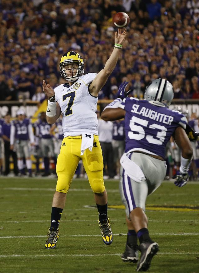 Michigan's Shane Morris (7) gets off a pass as Kansas State's Blake Slaughter (53) applies late pressure during the first half of the Buffalo Wild Wings Bowl NCAA college football game on Saturday, Dec. 28, 2013, in Tempe, Ariz. (AP Photo/Ross D. Franklin)