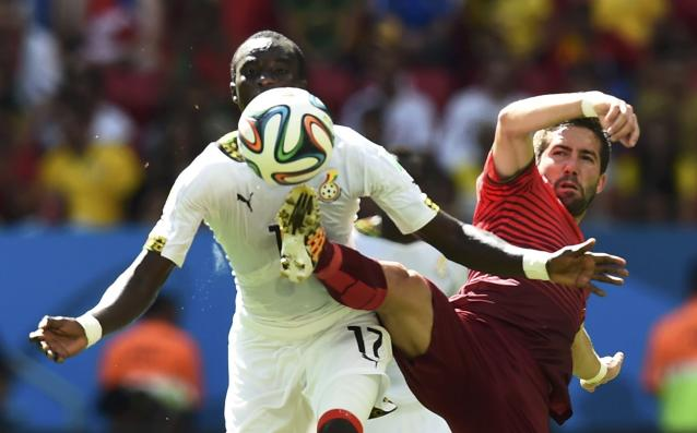 Ghana's Mohammed Rabiu (L) is challenged by Portugal's Joao Moutinho during their 2014 World Cup Group G soccer match at the Brasilia national stadium in Brasilia June 26, 2014. REUTERS/Dylan Martinez (BRAZIL - Tags: SOCCER SPORT WORLD CUP)
