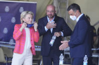 EU Commission president Ursula von der Leyen, left, EU Council President Charles Michel, center, and Spain's Prime Minister Pedro Sanchez prepare for a joint news conference at the Torrejon military airbase in Madrid, Spain, Saturday, Aug. 21, 2021. Top European Union officials visited a Spanish military airport being used as a hub to receive Afghans flown out of Kabul before they are distributed to other countries in the bloc. (AP Photo/Paul White)
