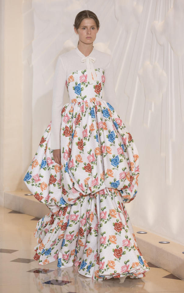 <p>Emilia Wickstead never fails to wow the fashion crowd with beautiful florals and fairy tale silhouettes. We'll be imitating this look and investing in a crisp white shirt to layer beneath a bubble-effect dress, asap. <em>[Photo: PA]</em> </p>