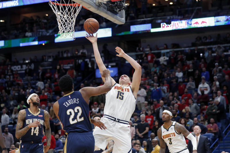 Denver Nuggets center Nikola Jokic (15) shoots against New Orleans Pelicans center Derrick Favors (22) in the first half of an NBA basketball game in New Orleans, Friday, Jan. 24, 2020. (AP Photo/Gerald Herbert)