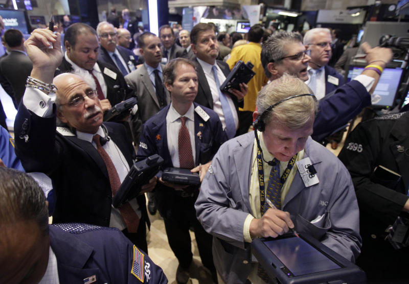 Traders work on the floor of the New York Stock Exchange Tuesday, July 31, 2012. U.S. stocks are opening mostly lower ahead of a two-day policy meeting at the Federal Reserve. (AP Photo/Richard Drew)
