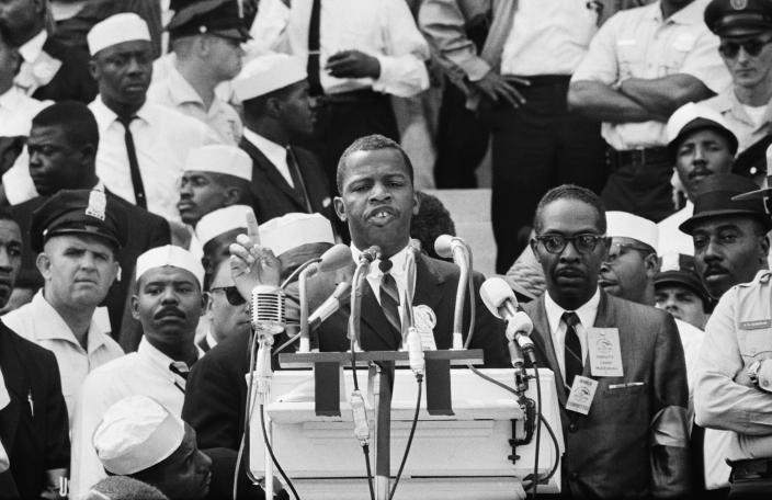 John Lewis, Chairman of the Student Nonviolent Coordinating Committee, speaking at the Lincoln Memorial to participants in the March on Washington on August 28, 1963. (Photo: Bettmann Archive/Getty Images)