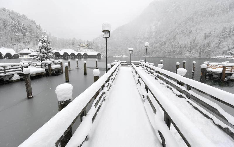 A pier is snow covered after heavy snow falls during the night at the Koenigssee lake in Berchtesgaden, southern Germany, Saturday, Jan.5, 2019. (Tobias Hase/dpa via AP)