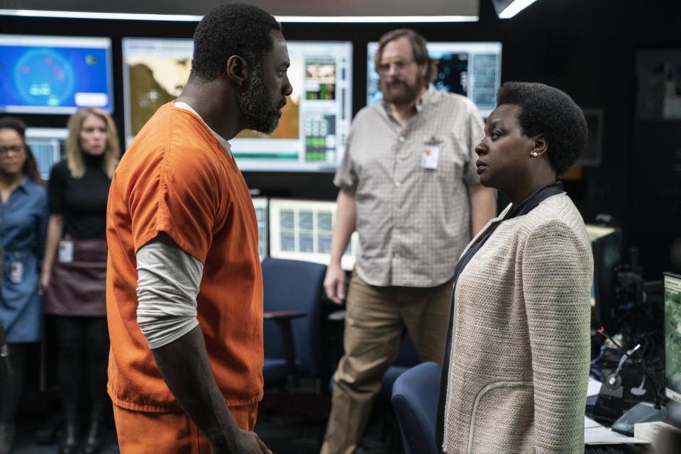 """This image provided by Warner Bros. Pictures shows Idris Elba, left, and Viola Davis in a scene from """"The Suicide Squad."""" (Warner Bros. Pictures via AP)"""