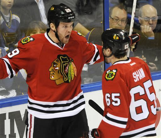 Chicago Blackhawks' Bryan Bickell (29) celebrates his goal against the St. Louis Blues with Andrew Shaw(65) in the second period of an NHL hockey game Sunday April 14, 2013, in St. Louis. (AP Photo/Bill Boyce)