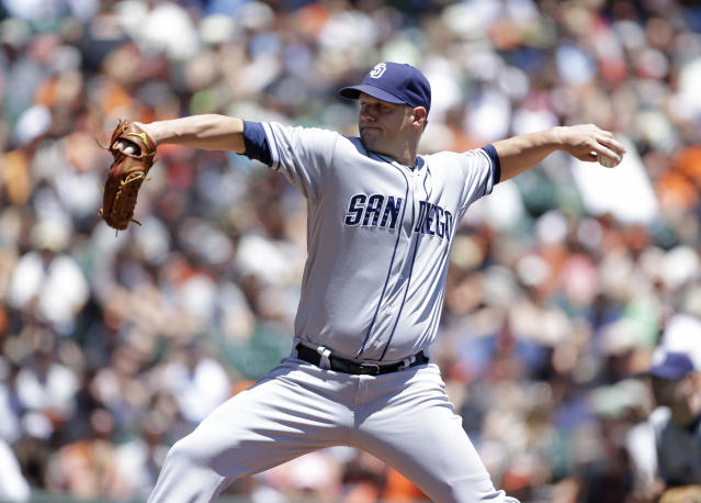 San Diego Padres starting pitcher Eric Stults throws against the San Francisco Giants in the first inning of a baseball game Wednesday, June 19, 2013 in San Francisco. (AP Photo/Eric Risberg)