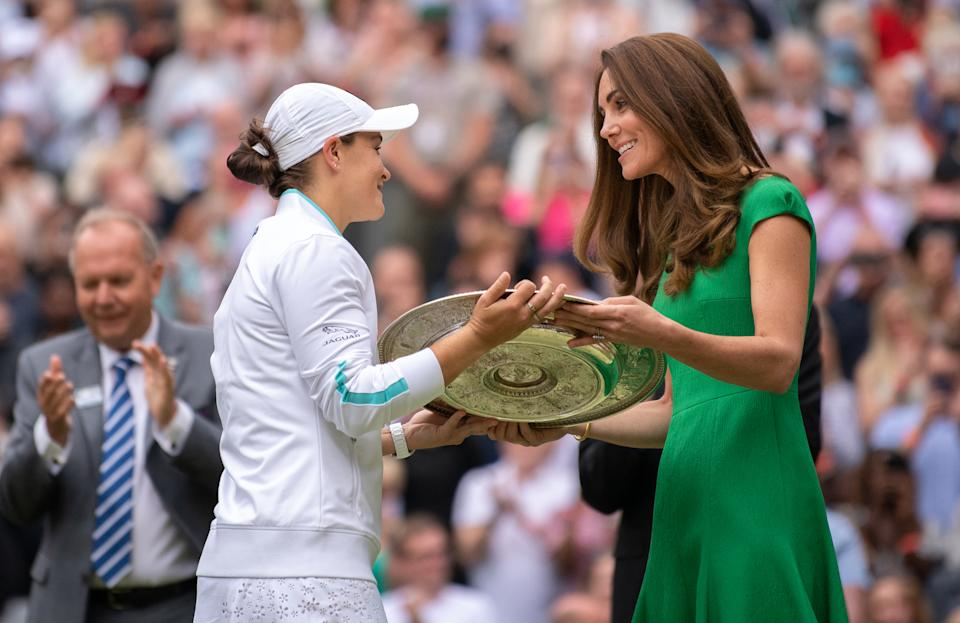 LONDON, ENGLAND - JULY 10: Ashleigh Barty of Australia is presented with the Venus Rosewater Dish trophy by HRH Catherine, The Duchess of Cambridge after winning her Ladies' Singles Final match against Karolina Pliskova of The Czech Republic  on Day Twelve of The Championships - Wimbledon 2021 at All England Lawn Tennis and Croquet Club on July 10, 2021 in London, England. (Photo by AELTC/Ben Solomon - Pool/Getty Images)