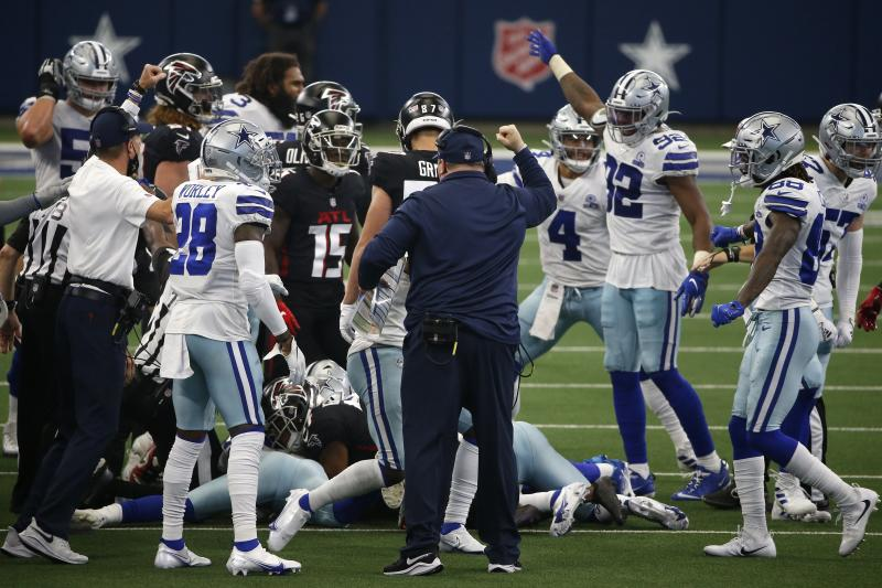 Dallas Cowboys head coach Mike McCarthy, center with hand raised, celebrates an onside kick recovery in the second half of an NFL football game against the Atlanta Falcons in Arlington, Texas, Sunday, Sept. 20, 2020. (AP Photo/Ron Jenkins)