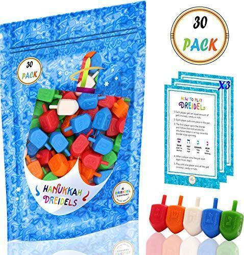 """<p><strong>The Dreidel Company</strong></p><p>amazon.com</p><p><a href=""""https://www.amazon.com/dp/B076ZVHMCF?tag=syn-yahoo-20&ascsubtag=%5Bartid%7C10049.g.33852512%5Bsrc%7Cyahoo-us"""" rel=""""nofollow noopener"""" target=""""_blank"""" data-ylk=""""slk:Shop Now"""" class=""""link rapid-noclick-resp"""">Shop Now</a></p><p>Yes, the kids can play this one too, but the grownups can give the classic game a twist by adding booze into the mix.</p>"""